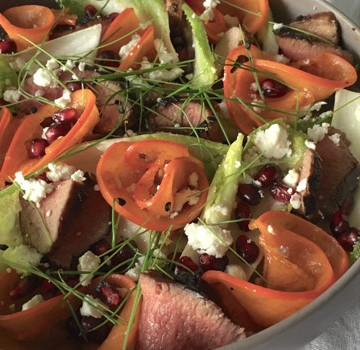 Pomegranate salad with glazed lamb