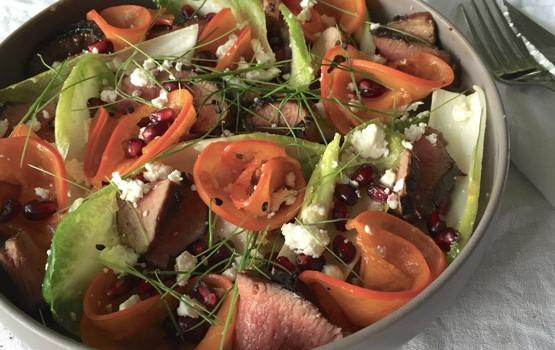 Pomegranate salad with glazed lamb